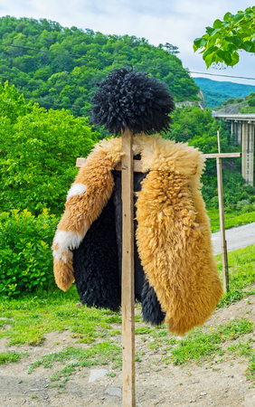 papakha: The traditional Georgian shepherds dress - the hat (papakha) and coat of sheeps fur, Ananuri, Georgia.