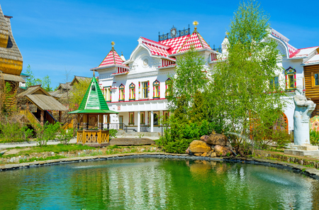 entertainment center: The tiny garden with a pond among the mansions, museums and workshops of Izmailovsky Kremlin, the Russian style cultural, art and entertainment center, Moscow, Russia. Editorial