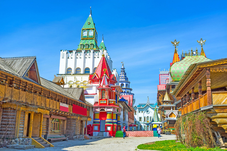 doubleheaded: The unique entertainment complex of Izmailovsky Kremlin contains examples of traditional Russian architecture - the timbered St Nicholas Church, Tsars Palace, colorful mansions and towers, Moscow, Russia.