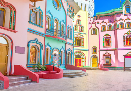 The colorful mansions decorated with numerous painted details and scenic patterns, Izmailovsky Kremlin, Moscow, Russia.