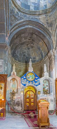 GERGETI, GEORGIA - JUNE 3, 2016: The parayer hall of Tsminda Sameba (Holy Trinity) Church with the old stone iconostasis, on June 3 in Gergeti.