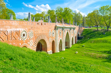 grecas: MOSCOW, RUSSIA - MAY 10, 2015: The Big Bridge over the Ravine in Tsaritsyno decorated with patterned fretwork , columns and arches, on May 10 in Moscow.