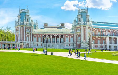 MOSCOW, RUSSIA - MAY 10, 2015: The facade of the Grand Palace of Tsaritsyno Royal Residence decorated with towers, patterns, fretwork and surrounded by lawn, on May 10 in Moscow. Editorial