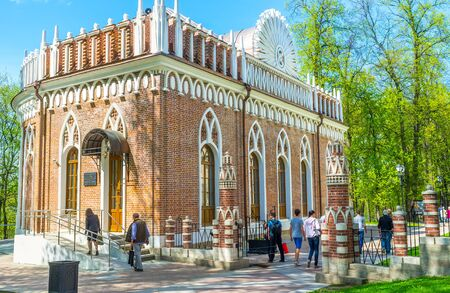 MOSCOW, RUSSIA - MAY 10, 2015: The tourists visit Small Palace (Semicircular Palace) of Imperial Residence in Tsaritsyno, the perfect place to enjoy beauty of nature and splendor of architecture, on May 10 in Moscow.