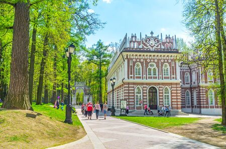 MOSCOW, RUSSIA - MAY 10, 2015: The facade of the Small Palace (Semicircular Palace) of Tsaritsyno Royal Estate, decorated with white patterns, Gothic elements and Double-Headed Eagle on the top, on May 10 in Moscow.