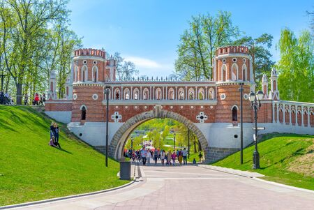 MOSCOW, RUSSIA - MAY 10, 2015: The Figured Bridge of Tsaritsyno Royal Estate separates the square of the Grand Palace from the lower park with cascade of ponds, on May 10 in Moscow. Editorial