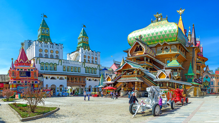 MOSCOW, RUSSIA - MAY 10, 2015: Panorama of the central square of Izmailovsky Kremlin with the timbered Tsars Palace and huge decorative central gate with green towers, on May 10 in Moscow.