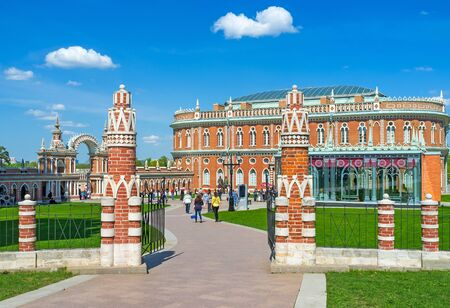 MOSCOW, RUSSIA - MAY 10, 2015: The Kitchen Quarters (Bread House) of Tsaritsyno Royal Estate surrounded by decorative fence with brick columns, decorated in Gothic style, on May 10 in Moscow.