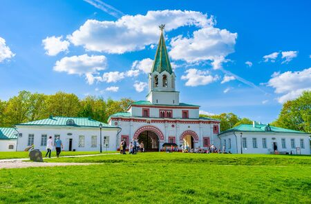 MOSCOW, RUSSIA - MAY 10, 2015: The Front Palace Gate of Kolomenskoye Royal Estate decorated with patterns, tall bell tower with the Double-Headed Eagle on the weathervane, on May 10 in Moscow.