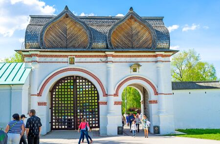 MOSCOW, RUSSIA - MAY 10, 2015: The tourists walks through the Spassky Rear Gate, leading to the Kolomenskoye Royal Estate, on May 10 in Moscow.