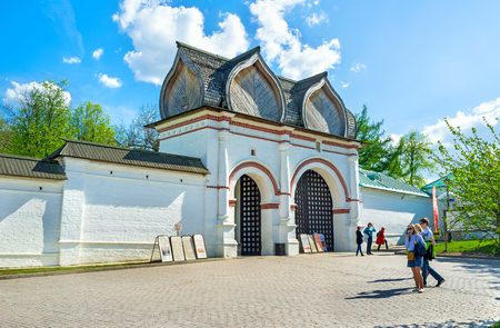 spassky: MOSCOW, RUSSIA - MAY 10, 2015: The white Spassky Rear Gate with the figured wooden roof leads to the Kolomenskoye Royal Estate, on May 10 in Moscow.