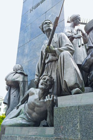poems: The sculptures of dying Gaydamak and Gaydamak with a scythe - the characters from poems of Taras Shevchenko, located at the foot of his Monument in Kharkov, Ukraine. Editorial