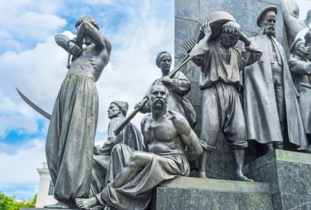siervo: The statues of Ukrainian peasants -serfs around the monument to the famous poet, writer and freedom fighter - Taras Shevchenko, who was the serf by himself, Kharkov, Ukraine. Editorial