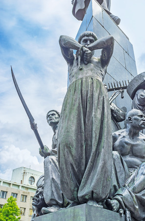 siervo: The statue of the serf, tearing his shackles at the monument of Ukrainian poet - Taras Shevchenko, who was the serf by himself, Kharkov, Ukraine. Editorial