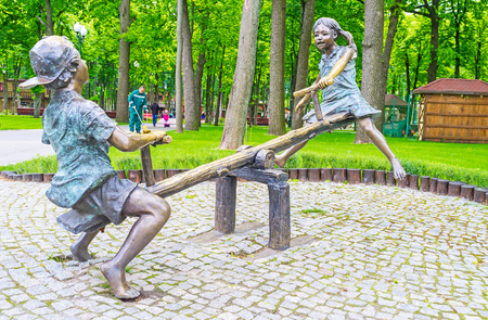 gorky: KHARKOV, UKRAINE - MAY 20, 2016: The bronze sculpture of children, playing on a seesaw, Gorky Park, on May 20 in Kharkov. Editorial