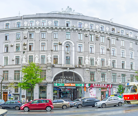 kharkov: KHARKOV, UKRAINE - MAY 20, 2016: The huge building of Palace of Labor decorated with the white sculptures of workers, on May 20 in Kharkov.