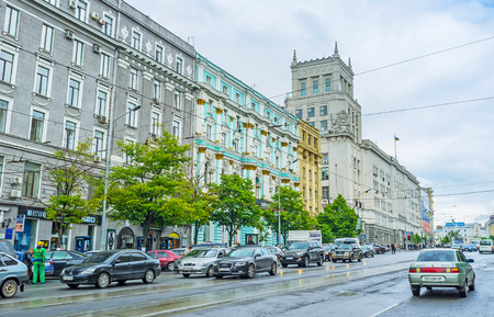 kharkov: KHARKOV, UKRAINE - MAY 20, 2016: The view of Konstitutsii Square with the tower of City Counsil, on May 20 in Kharkov. Editorial