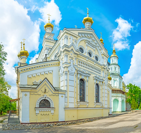 The yellow building of the Church of Holy Virgin Lady of Ozeriana is the part of Holy Virgin Monastery,  Kharkov, Ukraine.