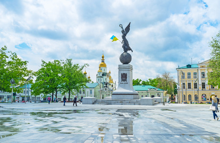 KHARKOV, UKRAINE - MAY 20, 2016: The Independence Monument, named Flying Ukraine with the golden bell towers of the Holy Virgin Monastery on the background, on May 20 in Kharkov.