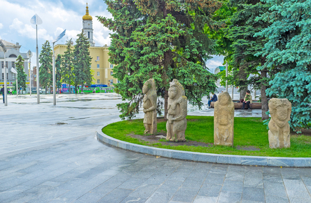 KHARKOV, UKRAINE - MAY 20, 2016: The stone idols of the ancient Slavs and Scythians decorate the flowerbed and attract people to visit State Historical Museum, on May 20 in Kharkov.
