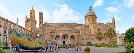city park boat house: PALERMO, ITALY - OCTOBER 2, 2012: Avenue of Vittorio Emanuele decorated with the colorful carriage of Santa Rosalia, dedicated to her feast, with the carved stone Cathedral on background, on October 2 in Palermo.