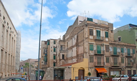 architecture monumental: PALERMO, ITALY - OCTOBER 2, 2012: The old city districts are full of ruined residential buildings and slums, neighboring with the monumental architecture, on October 2 in Palermo.