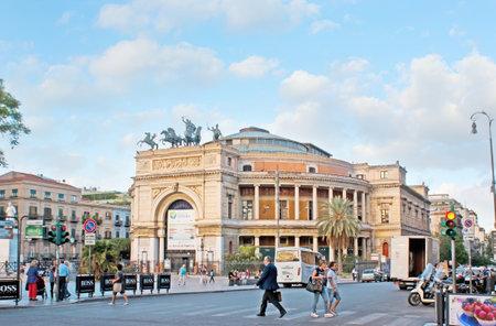 quadriga: PALERMO, ITALY - OCTOBER 2, 2012: The facade of impressive Politeama Theater, located in Square of Ruggero Settimo and decorated with the Triumphal Arch and bronze quadriga, on October 2 in Palermo.