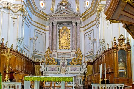 POSITANO, ITALY - OCTOBER 5, 2012: The classical interior of Santa Maria Assunta Cathedral with the Black Madonna icon over the altar, on October 5 in Positano.