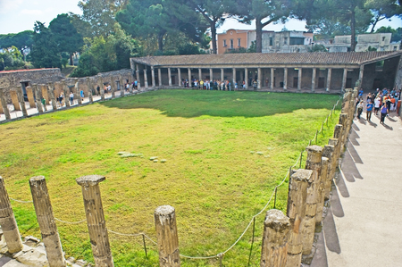 POMPEII, ITALY - OCTOBER 4, 2012: The gladiators of the city lived around the Quadriporch, nowadays with preserved columns and walls, on October 4 in Pompeii.