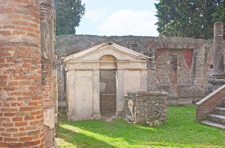 The Purgatorium of Temple of Isis, surrounded by stone columns and ruined walls, Pompeii, Italy.