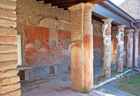 The remains of the painted decorations in the covered gallery of ancient Roman villa in Pompeii, Italy. Editorial