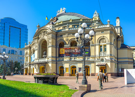 national poet: KIEV, UKRAINE - SEPTEMBER 8, 2016: The facade Taras Shevchenko National Opera House, located in Vladimirskaya Street, the main arch decorated with the bust of famous poet, on September 8 in Kiev.