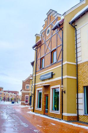 KIEV, UKRAINE - NOVEMBER 11, 2016: The Dutch style stepped gable house in the modern shopping city, on November 11 in Kiev.