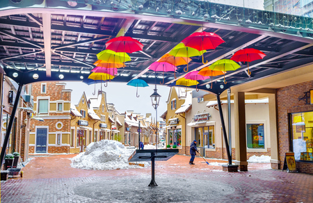 KIEV, UKRAINE - NOVEMBER 11, 2016: The colorful umbrellas in covered gallery of Dutch style shopping city remind about warm days, on November 11 in Kiev.