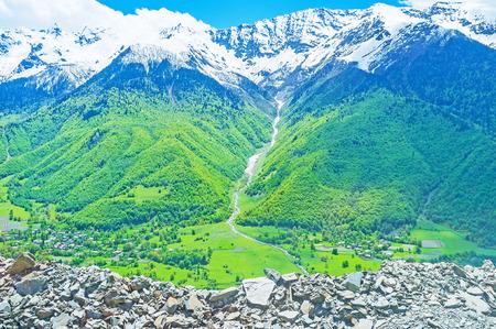 The tiny waterfall in the narrow gorge in Caucasus mountains, Upper Svaneti, Georgia.