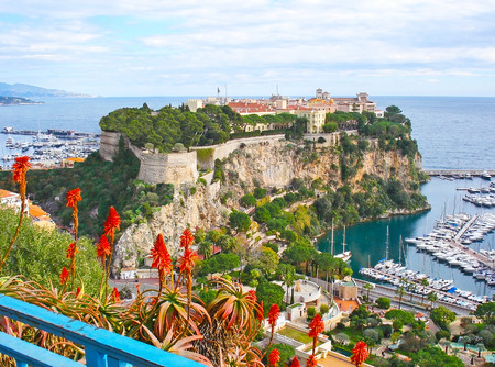 The Rock of Monaco, located between two ports at Mediterranean coast, its occupied with the oldest city ward - Monaco-Ville, surrounded by citadel walls.