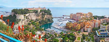 Panorama of Monaco coast with the medieval Monaco-Ville ward, located on the Rock, new port and the modern Fontvieille ward.