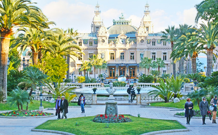 MONACO - FEBRUARY 21, 2012: The green gardens of Monte Carlo boast great landscaping in french style, nice fountains, sculptures and views on Salle Garnier - Opera and luxury Casino, on February 21 in Monaco.