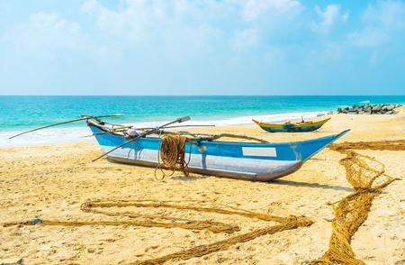 The boats and nets dry on the beach and wait for the next fishing, Hikkaduwa, Sri Lanka. Stock Photo