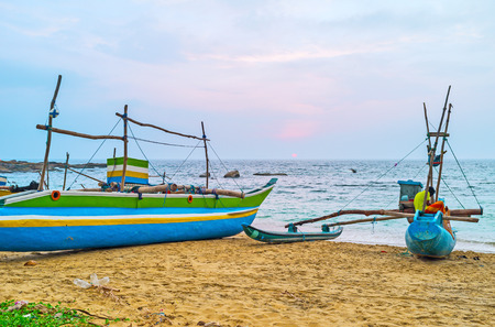 The view from the fishing harbor on the foggy sunset over the ocean, Hikkaduwa, Sri Lanka.