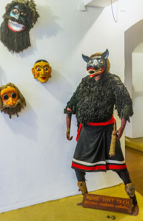 AMBALANGODA, SRI LANKA - DECEMBER 5, 2016: The mannequin in costume and mask for the Devil Dance in mask museum, on December 5 in Ambalangoda.