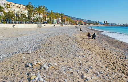 menton: The sand beach of Menton is the nice place for the daily walks during the cold months, France.
