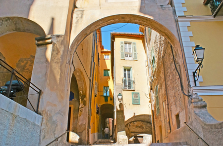 menton: The numerous arched passes in Mattoni street, located in medieval part of town with preserved residential housing, Menton, France.