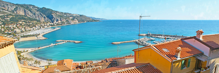 menton: Panorama of the coastline with yacht ports, piers, beaches and tile red roofs from the Old Castle Hill, Menton, France. Stock Photo
