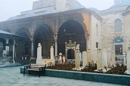 The small cemetery with old stone tomb stones located in front of the entrance to Mevlana Mausoleum, Konya, Turkey.