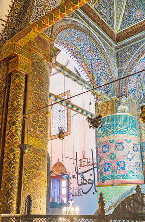 KONYA, TURKEY - JANUARY 20, 2015: The walls and seiling of the old Mausoleum in Mevlana Museum decorated with islamic patterns and calligraphy, on January 20 in Konya. Editorial