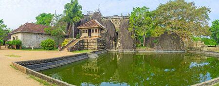 The scenic pond of Isurumuniya Viharaya (Monastery), with the giant rock on the background, Anuradhapura, Sri Lanka.