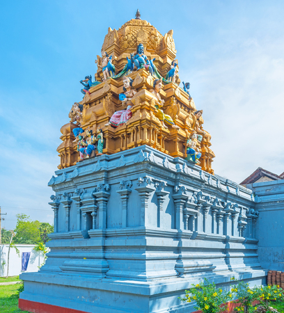 dome of hindu temple: The colorful decoration of Sri Kadhiresan Kovil Temple, golden dome with plaster sculptures of Hindu Gods, Anuradhapura, Sri Lanka. Stock Photo