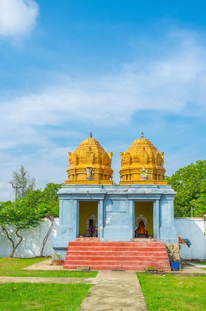 dome of hindu temple: The double shrine in Sri Kadhiresan Kovil Temple with beautiful golden domes, decorated with carved patterns and sculptures, Anuradhapura, Sri Lanka. Stock Photo