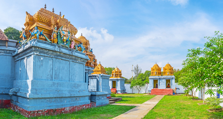 dome of hindu temple: Panorama of Sri Kadhiresan Kovil Temple with carved patterns on domes, sculptures of Hindu Gods and small shrines around the main building, Anuradhapura, Sri Lanka. Stock Photo